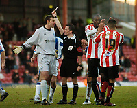 Photo: Leigh Quinnell.<br /> Brentford v Huddersfield Town. Coca Cola League 1. 21/01/2006. Brentfords Lloyd Owusu and Dudley Campbell celebrate as Huddersfield goalkeeper Paul Ruchubka is sent off.