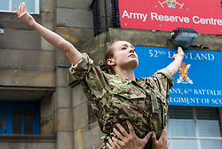 Brigadier Gary Deakin CBE welcomes performers to the Army reserve centre at Hepburn House for the opening of the Army's first ever Edinburgh Festival Fringe venue.<br /> <br /> Pictured: Performer from the Rosie Kay Dance Company production of 5 Soldiers