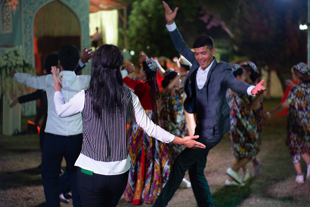 Photographs and portraits from the First International Handicraft Festival in Kokand, Uzbekistan, celebrating traditional handicrafts from around the world.l