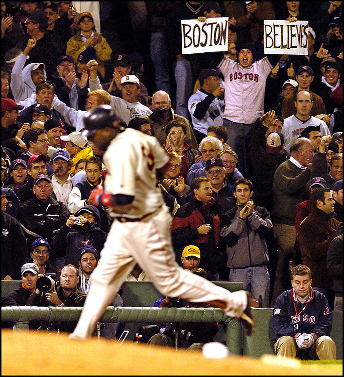 (10/18/04 Boston, MA) Red Sox vs Yankees Game 5.  Sox fans keep believing as David Ortiz rounds third after he starts the 8th inning with a solo HR. (101804soxmjs-staff photo by Michael Seamans. Saved in photo Tuesday/cd)