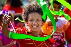 A young performer waves a ribbon as day one, Children's Day, of the Notting Hill Carnival gets underway in London. London, August 25 2019.