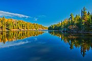 Reflection in autumn on Blindfold Lke. Storm Bay Road. <br />Near Kenora<br />Ontario<br />Canada