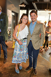 RUPERT & ANNA KNAUS at a party to celebrate the publication of 'Feeding The Future' by Lohralee Astor and Tali Shine held at OKA, 155-167 Fulham Road, London on 8th June 2016.