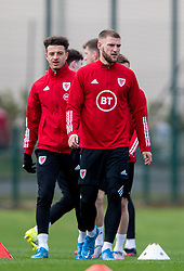 CARDIFF, WALES - Monday, March 29, 2021: Wales' Ethan Ampadu (L) and Brandon Cooper during a training session at the Vale Resort ahead of the FIFA World Cup Qatar 2022 Qualifying Group E game against the Czech Republic. (Pic by David Rawcliffe/Propaganda)
