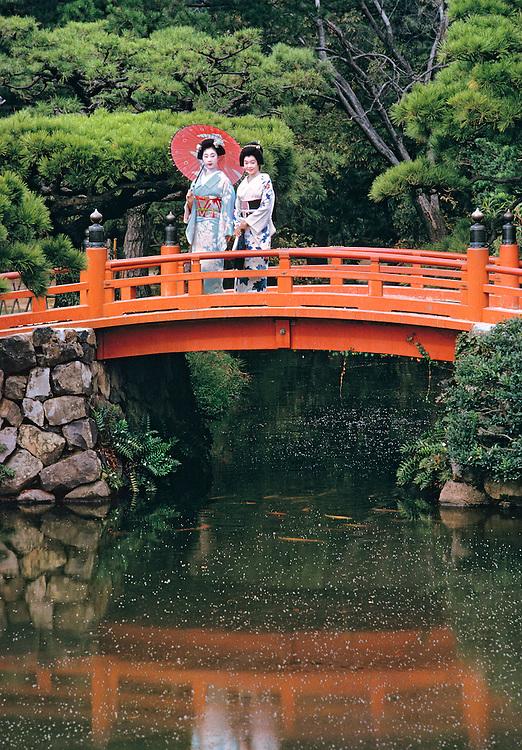 Models in formal kimono pose on a bridge in Ritsurin Park in Takamatsu, Shikoku, Japan.