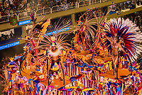 Performers on floats in the Carnaval parade of Grande Rio samba school in the Sambadrome, Rio de Janeiro, Brazil.
