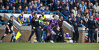 Fleetwood Town manager Graham Alexander urges his team to victory during injury time as Gillingham's goalkeeper Glenn Morris takes a free kick<br /> <br /> Photographer Stephen White/CameraSport<br /> <br /> Football - The Football League Sky Bet League One - Gillingham v Fleetwood Town -  Friday 3rd April 2015 - MEMS Priestfield Stadium - Gillingham<br /> <br /> © CameraSport - 43 Linden Ave. Countesthorpe. Leicester. England. LE8 5PG - Tel: +44 (0) 116 277 4147 - admin@camerasport.com - www.camerasport.com