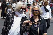 Shoppers wearing face coverings pass through the town centre on 14th July 2021 in Windsor, United Kingdom. The UK government announced on 12th July that England will move to the final stage of easing Covid-19 restrictions on 19th July, with almost all legal restrictions on social contact removed, but they also advised the public to exercise caution given that the current wave driven by the Delta variant is not expected to peak until mid-August.