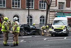 © Licensed to London News Pictures. 11/02/2021. London, UK. Emergency services at the scene at Tavistock Square in London where a police car has been involved in a collision with another vehicle. Photo credit: Ben Cawthra/LNP
