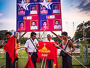 06 NOVEMBER 2015 - YANGON, MYANMAR:  NDF supporters take down the NDF flags at the end of the final NDF election rally of the 2015 election. The rally was held in central Yangon, next to the historic Sule Pagoda and across the street from Yangon city hall. The National Democratic Force (NDF) was formed by former members of the National League for Democracy (NLD) who chose to contest the 2010 general election in Myanmar because the NLD boycotted that election. There have been mass defections from the NFD this year because many of the people who joined the NFD in 2010 have gone back to the NLD, which is contesting this year's election and widely expected to win it. Campaigning in the Myanmar election ended Friday. People go to the polls Sunday.    PHOTO BY JACK KURTZ