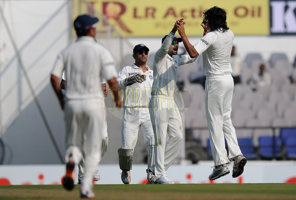 Ishant Sharma of India celebrates the wicket of Nick Compton of England with teammates during day one of the 4th Airtel Test Match between India and England held at VCA ground in Nagpur on the 13th December 2012..Photo by  Pal Pillai/BCCI/SPORTZPICS .