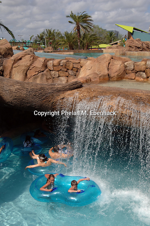 Park guests float down the Loggerhead Lane lazy river at Sea World's new waterpark Aquatica in Orlando, Florida.