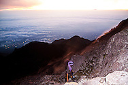 A climber ascends Mount Merapi in Central Java at dawn, Indonesia, Southeast Asia