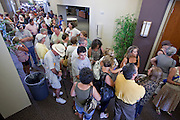 Aug 26, 2009 -- PHOENIX, AZ: People wait in line to attend Sen John McCain's town hall meeting on health care at North Phoenix Baptist Church in Phoenix, AZ, Wednesday. Sen McCain hosted his second town hall meeting on health care in two days Wednesday. About 1,000 people attended the meeting. Although most were opposed to President Obama's health care proposals and supported Sen McCain, there was a large group who support the President's health care efforts.  Photo by Jack Kurtz