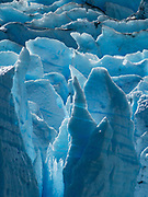 Jumbled seracs of Grey Glacier  flow from the Southern Patagonian Ice Field into Lago Grey, in Torres del Paine National Park, Chile, Patagonia, South America. Before dividing in two at its tongue, the glacier is 6 kilometers wide and over 30 meters high. Grey Glacier has receded 4 km and lost 17 square kilometers from the mid 1900s through 2010.  Torres del Paine National Park is listed as a World Biosphere Reserve by UNESCO.