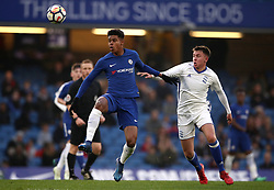 Chelsea's Tino Anjorin, (left) battles for possession of the ball with Birmingham City's Caloan Boyd-Munce, (right)