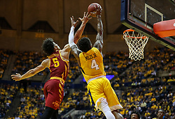 Feb 24, 2018; Morgantown, WV, USA; West Virginia Mountaineers guard Daxter Miles Jr. (4) jumps for an alley-oop and is defended by Iowa State Cyclones guard Lindell Wigginton (5) during the second half at WVU Coliseum. Mandatory Credit: Ben Queen-USA TODAY Sports