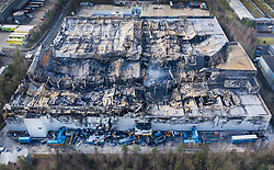 © Licensed to London News Pictures. 12/02/2019. Andover, UK. As the ruins still smoulder aerial photographs show the fire damage and the remains of the Ocado warehouse in Andover after the fire was mostly extinguished. The fire raged for three days starting a week ago with 300 fire fighters tackling the blaze at the giant robotic warehouse.  Photo credit: Peter Macdiarmid/LNP