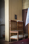 Chairs by confessional cabinet in Vilupulli Church, Chiloe Island, Chile