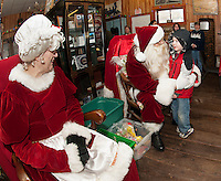 Jacob McNeil receives a special Christmas hug from Santa as he visits with Mr. and Mrs. Claus at the Lakeport Freight House Museum Saturday afternoon.  (Karen Bobotas/for the Laconia Daily Sun)