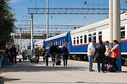Railway station of Almaty with passengers and trains, Kazakhstan