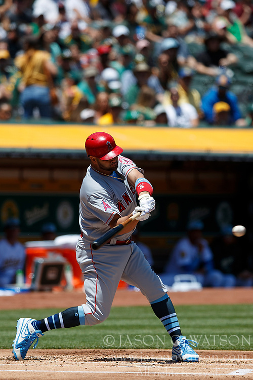 OAKLAND, CA - JUNE 17: Albert Pujols #5 of the Los Angeles Angels of Anaheim at bat against the Oakland Athletics  during the first inning at the Oakland Coliseum on June 17, 2018 in Oakland, California. The Oakland Athletics defeated the Los Angeles Angels of Anaheim 6-5 in 11 innings. (Photo by Jason O. Watson/Getty Images) *** Local Caption *** Albert Pujols