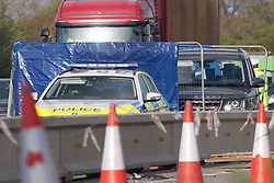 © Licensed to London News Pictures. 07/05/2021. Slough, UK. A police vehicle and a privacy barrier following a serious collision between a motorcycle and a car on the M4 motorway westbound between junction 5 and junction 6 causing major delays to Friday rush-hour traffic. The stretch of motorway is currently being converted into a smart motorway with major roadworks due to be completed in 2022. Photo credit: Peter Manning/LNP