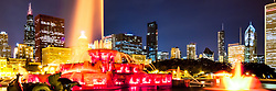 Chicago skyline at night panorama photo. Panoramic picture ratio is 1:3 and includes Buckingham Fountain, Willis Tower (Sears Tower), CNA building, Trump Tower, Prudential plaza, and other Chicago buildings.