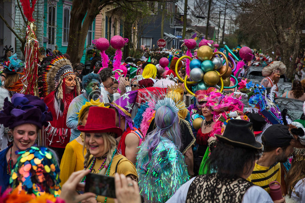 The Society of Saint Anne gathering to parade during Mardi Gras on 25th February 2020 in Bywater district of New Orleans, Louisiana, United States. Mardi Gras is the biggest celebration the city of New Orleans hosts every year. The magnificent, costumed, beaded and feathered party is laced with tradition and  having a good time. Celebrations are concentrated for about two weeks before and culminate on Fat Tuesday the day before Ash Wednesday and Lent. Unknown to the participants and local leaders at the time, the 2020 Carnival season with parades running from January through Mardi Gras Day on February 25 coincided with increasing spread of coronavirus disease 2019 COVID-19 in the United States as part of a global pandemic. At the time, the disease was actively being dismissed as a major public health threat by the Trump administration. Researchers of the University of Louisiana at Lafayette estimated that Louisiana had the fastest growth rate of cases 67.8%, overtaking overtaking New Yorks 66.1% growth in the 14 days since its first reported case than any region in the world. Mayor LaToya Cantrell stated that she would have cancelled Mardi Gras festivities had she been provided with sufficient warning by the federal government, and criticized the Trump administration for downplaying the threat.