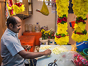 05 JUNE 2015 - KUALA LUMPUR, MALAYSIA: Vendors in the Little India section of Kuala Lumpur make flower garlands used in Hindu prayers and offerings.     PHOTO BY JACK KURTZ