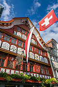 Beautiful paintings of medicinal herbs decorate the facade of Löwen pharmacy in Appenzell village, Switzerland, Europe. Johannes Hugentobler painted medicinal herbs on the round-arched panels covering the shutters. Appenzell Innerrhoden is Switzerland's most traditional and smallest-population canton (second smallest by area).