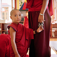 Tsewang Zangmo, a young novice, has just arrived from the border between Nepal and Tibet. As a school without tuition fees, the community welcomes young girls from very poor families or orphans and provides them with a good education - Shugsep nunnery, Dharamsala, India, 2010