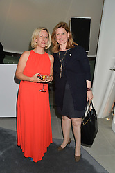 Left to right, BEC ASTLEY CLARKE and SARAH BROWN at a summer drinks party hosted by Bec Astley Clarke at the Serpentine Sackler Gallery, Hyde Park, London on 17th June 2014.