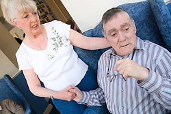 Woman visiting her husband who has Alzheimer's Disease at the Nursing Home where he lives,