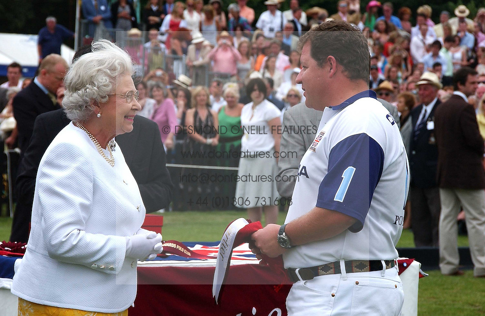 HM THE QUEEN and  TONY PIDGLEY at the Queen's Cup polo final sponsored by Cartier at Guards Polo Club, Smith's Lawn, Windsor Great Park on 18th June 2006.  The Final was between Dubai and the Broncos polo teams with Dubai winning.<br /><br />NON EXCLUSIVE - WORLD RIGHTS