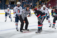 KELOWNA, CANADA - SEPTEMBER 5: Linesman Dustin Minty stands at the face off between Ted Brennan #10 of the Kelowna Rockets and Connor Zary #18 of the Kamloops Blazers on September 5, 2017 at Prospera Place in Kelowna, British Columbia, Canada.  (Photo by Marissa Baecker/Shoot the Breeze)  *** Local Caption ***