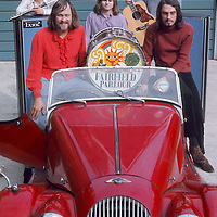 """Fairfield Parlour pre-festival publicity shoot (with Red Morgan).- .Once known as Kaleidoscope, the group re-launched their career in 1970 as Fairfield Parlour,via a quick pseudonym as """"I Luv Wight"""" under which name they wrote the opening theme to the festival """"Let the World Wash In"""". It went down like a lead balloon, but allowed them the chance to appear as the opening act, opening their horizons to even greater successes"""