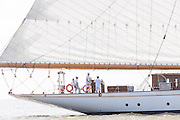 The crew steers the 196-foot sailing yacht Germania Nova as it sails Charleston Harbor June 26, 2013 in Charleston, South Carolina.
