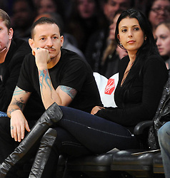 ©2011 GAMEPIKS 310-828-3445<br /> <br /> Linkin Park lead singer Chester Bennington and his wife Talinda Bentley sits courtside as he attends the Los Angeles Lakers/Portland Trail Blazers NBA game at Staples Center in Los Angeles on March 20, 2011. The Lakers defeated the Blazers 84-80.<br /> <br /> XYZ (Mega Agency TagID: MEGAR32159_1.jpg) [Photo via Mega Agency]