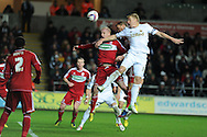 Pressure from Swansea's Gary Monk© sees Boro's Seb Hines head into his own net for the open ing goal.  Capital one cup, quarter final, Swansea city v Middlesbrough at the Liberty Stadium in Swansea, South Wales on Wednesday 12th Dec 2012. pic by Andrew Orchard, Andrew Orchard sports photography,
