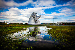 The Kelpies, the are 30-metre high horse-head sculptures, standing next to a new extension to the Forth and Clyde Canal in The Helix, a new parkland project built to connect 16 communities in the Falkirk Council Area, Scotland. The sculptures were designed by sculptor Andy Scott and were completed in October 2013. The sculptures form a gateway at the eastern entrance to the Forth and Clyde canal, and the new canal extension built as part of The Helix land transformation project. The Kelpies are a monument to horse powered heritage across Scotland.