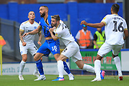 Jason Naismith pulls Aaron Wilbraham's shirt during the EFL Sky Bet League 1 match between Rochdale and Peterborough United at Spotland, Rochdale, England on 11 August 2018.