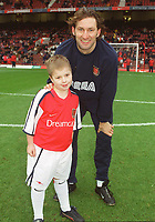 Arsenal captain Tony Adams with the mascot before the match. Arsenal 6:1 Leicester City, FA Carling Premiership, 26/12/2000. Credit Colorsport / Stuart MacFarlane.