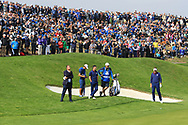 Rory McIlroy and Ian Poulter (Team Europe) on the 1st green during the Friday Foursomes at the Ryder Cup, Le Golf National, Ile-de-France, France. 28/09/2018.<br /> Picture Thos Caffrey / Golffile.ie<br /> <br /> All photo usage must carry mandatory copyright credit (© Golffile | Thos Caffrey)