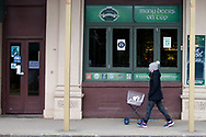 A woman walks by an Irish Pub during COVID-19 in Kilmore, Australia. An outbreak which started in Chadstone in Melbourne, has spread as far as Benalla. Twenty-eight people linked to the outbreak have now tested positive for COVID-19. There are now two confirmed cases in Kilmore linked with a Melbourne Resident who carried the virus into the town. The person visited the Odd Fellows Cafe in Kilmore which lead to him spreading the virus to a staff member, and a customer. The cafe has been closed for deep cleaning and will remain closed until the 19th October. (Photo by Dave Hewison/Speed Media)