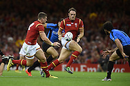 Cory Allen of Wales  collects a pass off Scott Williams of Wales. Rugby World Cup 2015 pool A match, Wales v Uruguay at the Millennium Stadium in Cardiff, South Wales  on Sunday 20th September 2015.<br /> pic by  Andrew Orchard, Andrew Orchard sports photography.