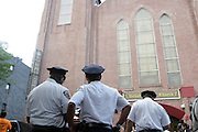 New York, NY- July 23: NYPD Officers attend the funeral of Eric Garner, who fell victim to the tactics of the NYPD after NYPD Officers rendered him in chokehold on July 20, 2014 in Staten Island. His funeral was held on July 23, 2014 at Bethel Baptist Church in New York City.  (Terrence Jennings)