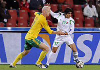Fotball<br /> Sør Afrika v Irak<br /> Foto: DPPI/Digitalsport<br /> NORWAY ONLY<br /> <br /> FOOTBALL - CONFEDERATIONS NATIONS CUP 2009 - GROUP A - 1ST ROUND - SOUTH AFRICA v IRAK - 14/06/2009<br /> <br /> ALAA ABDUL ZAHRA (ITA) / MATTHEW BOOTH (RSA)