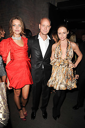 Left to right, NATALIA VODIANOVA, JUSTIN PORTMAN and STELLA McCARTNEY at The Love Ball hosted by Natalia Vodianova and Lucy Yeomans to raise funds for The Naked Heart Foundation held at The Round House, Chalk Farm, London on 23rd February 2010.