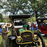 A man inspects a 1910 Rambler at the Greenwich Concours d'Elegance Festival of Speed and Style featuring great classic vintage cars. Roger Sherman Baldwin Park, Greenwich, Connecticut, USA.  2nd June 2012. Photo Tim Clayton
